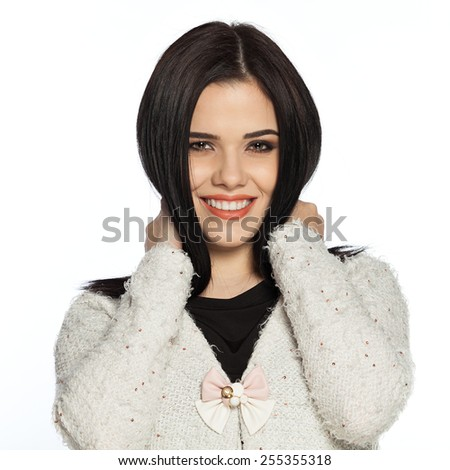 Smiling brunette young woman holding the hair close to her neck.  Gorgeous white caucasian female model feeling happy about her healthy hair. - stock photo