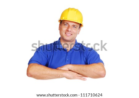 Smiling builder holding the blank board - stock photo