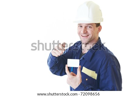 Smiling builder man in blue robe with visit card isolated on white - stock photo