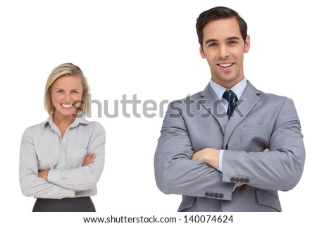 Smiling business co workers standing together on white background - stock photo