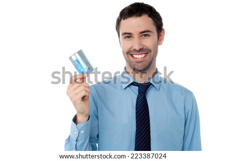 Smiling business executive holding credit card