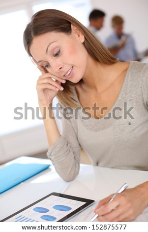 Smiling business girl working on budget