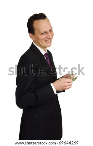 Smiling business man calculating his money, isolated on white background. - stock photo