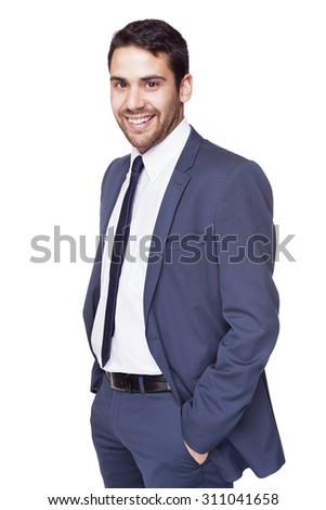 Smiling business man standing with hands on the pockets, isolated on white background