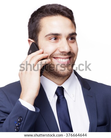 Smiling business man talking on the cell phone, isolated on white background - stock photo