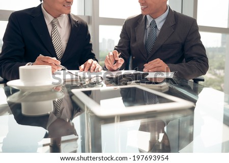 Smiling business partners working together - stock photo