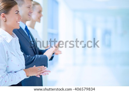 Smiling business people applauding a good presentation in the office - stock photo