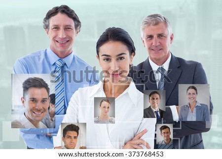 Smiling business people brainstorming together against view of cityscape