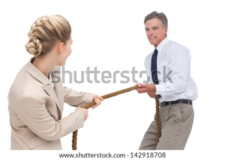 Smiling business people competing in pulling rope on white background - stock photo