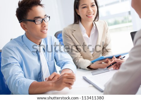 Smiling business people discussing the working plan - stock photo