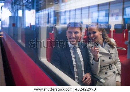 Smiling business people in a train