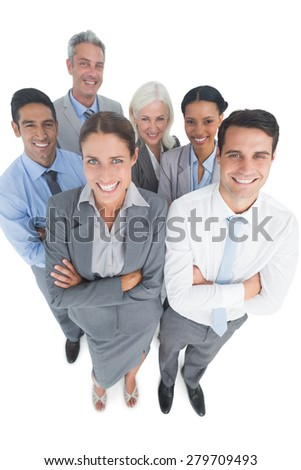 Smiling business people looking at camera with arms crossed on white background