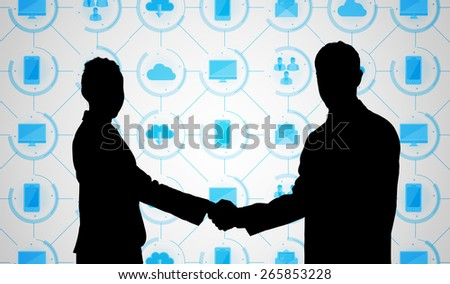 Smiling business people shaking hands while looking at the camera against app interface - stock photo