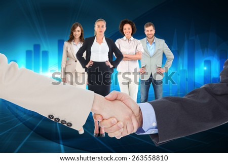 Smiling business people shaking hands while looking at the camera against blue bar chart graphic with light - stock photo