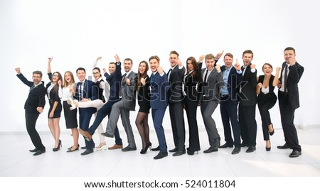 Smiling business people standing together in line in a modern of