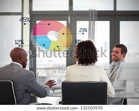 Smiling business people using colorful pie chart on futuristic interface in a meeting - stock photo
