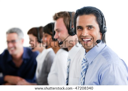 Smiling business people working in a call center against a white background - stock photo