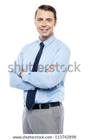Smiling business representative posing, arms folded. Isolated against white background