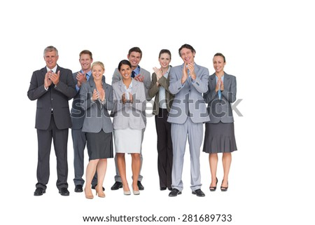 Smiling business team applauding at camera on white background
