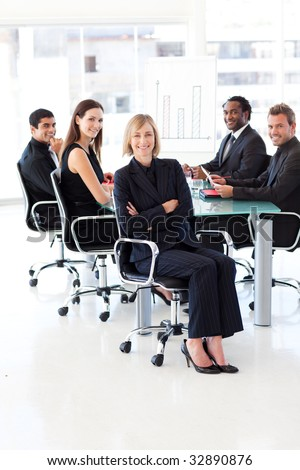 Smiling business team sitting in a meeting