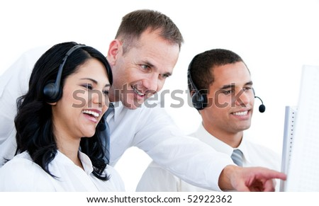 Smiling business team working on the computer against white background - stock photo