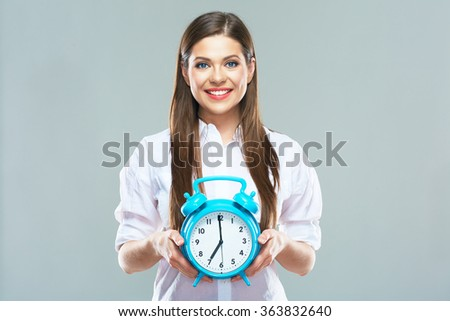 Smiling business woman hold alarm clock. Isolated portrait of young woman with long hair. Isolated. - stock photo