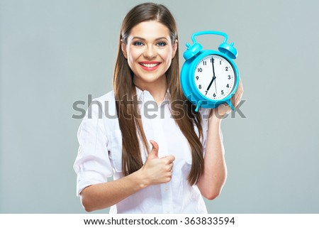 Smiling business woman hold watch and show thumb up. Studio portrait of young model with long hair.  - stock photo