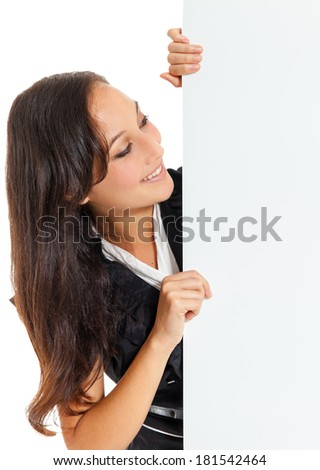Smiling business woman holding a blank sheet of paper on white to write your text.