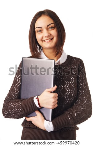 Smiling business woman holding a laptop - stock photo