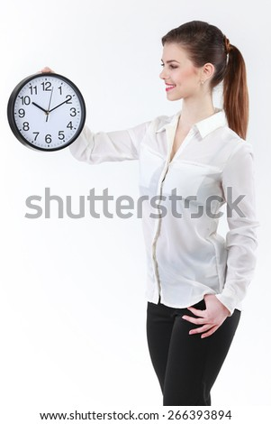 Smiling Business woman holding in hands clock, isolated on white background - stock photo
