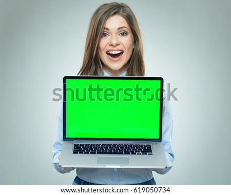 Smiling business woman holding laptop computer with copy space screen. Isolated portrait.