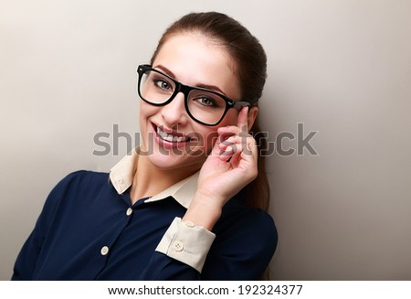Smiling business woman in glasses looking happy