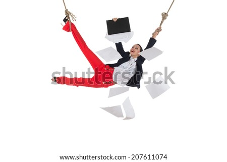 Smiling business woman is hanging on the rope against white background