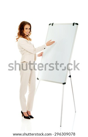 Smiling business woman near flipchart.