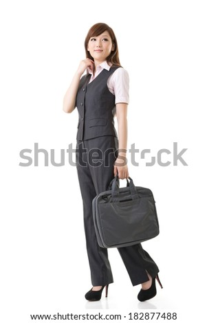 Smiling business woman of Asian, full length portrait isolated on white background.