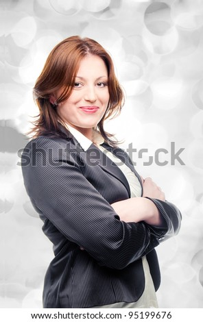 Smiling business woman on gray holiday lights - stock photo