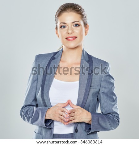 Smiling business woman portrait. Gray suit. Young female model.