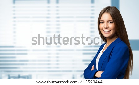 Smiling business woman portrait in her office