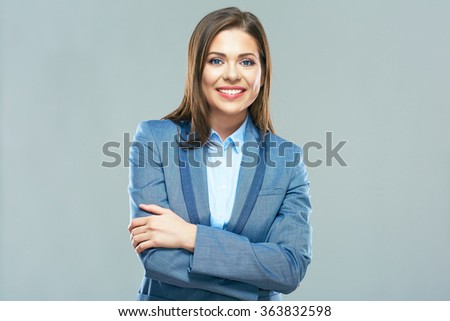 Smiling business woman portrait. Young female model with long hair. Isolated on studio background. - stock photo