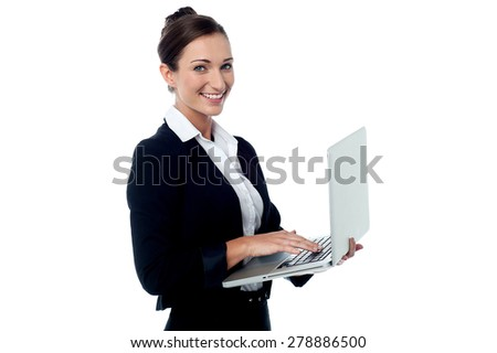 Smiling business woman posing with laptop - stock photo