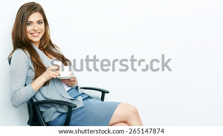 Smiling Business woman relaxed with coffee cup sitting in office chair. Isolated portrait. - stock photo