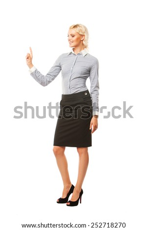Smiling business woman showing a copyspace isolated on white background - stock photo