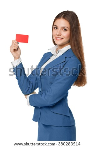 Smiling business woman showing blank credit card in blue suit, isolated over white background - stock photo