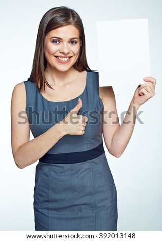 Smiling business  woman showing thumb up hold white sign board.