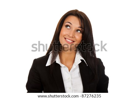 Smiling business woman standing think looking up. Isolated over white background