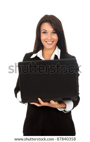 Smiling business woman standing with laptop. Isolated over white background