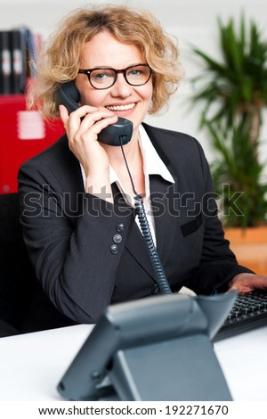 Smiling business woman talking via phone - stock photo