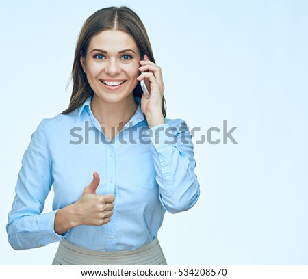 Smiling business woman using mobile phone show thumb up. isolated portrait. Long hair.