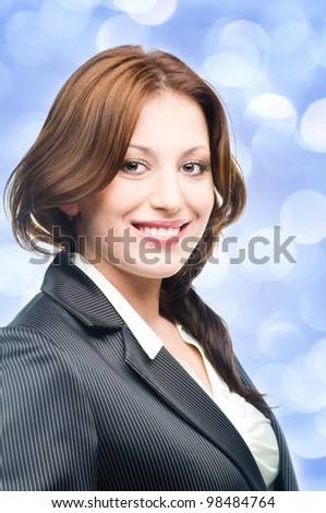 Smiling business woman with blue lights in the background - stock photo