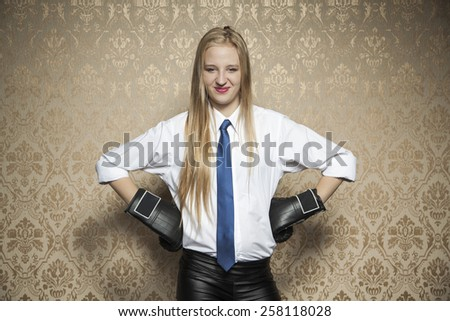 Smiling business woman with boxing gloves - stock photo